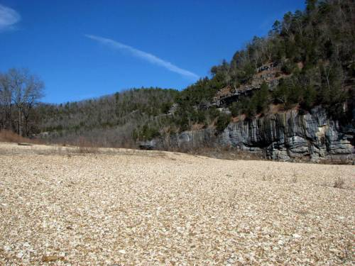 blue sky and rocky riverbank